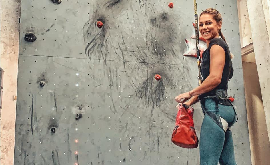 Climber poses with a wall