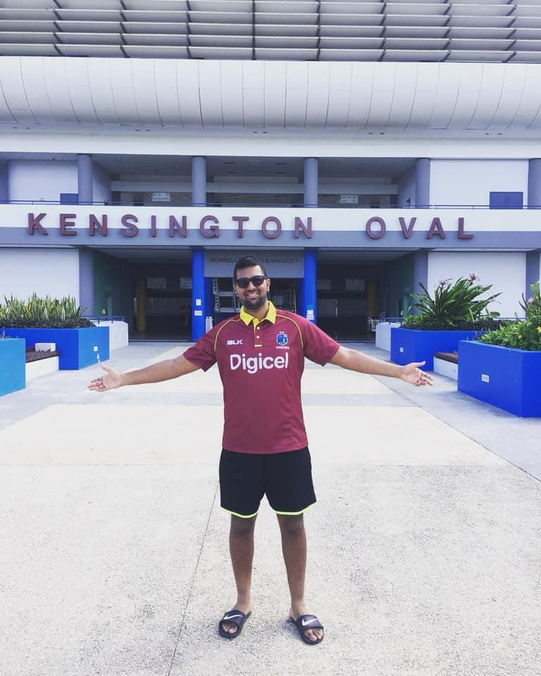 caribbean cricket podcast ,writer & co-host,wears red shirt,west indies