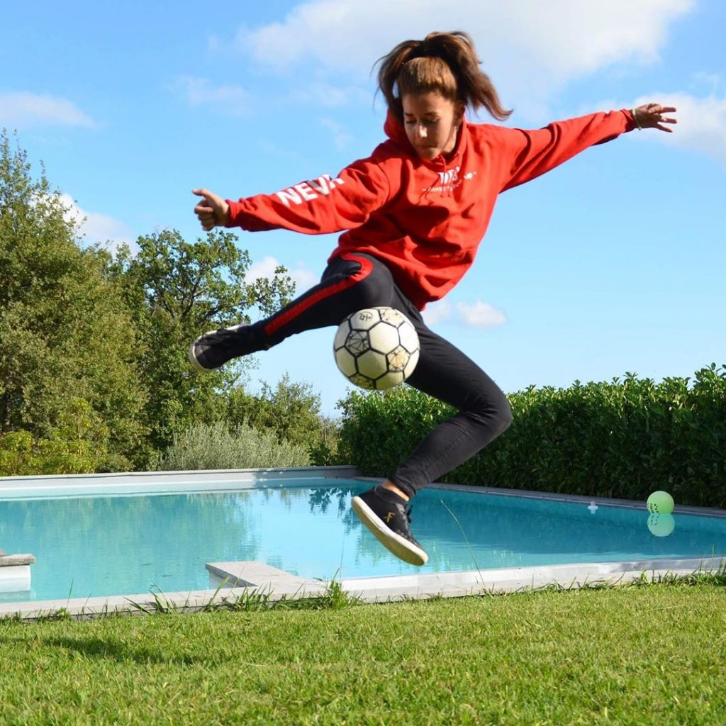 woman doing freestyle football trick
