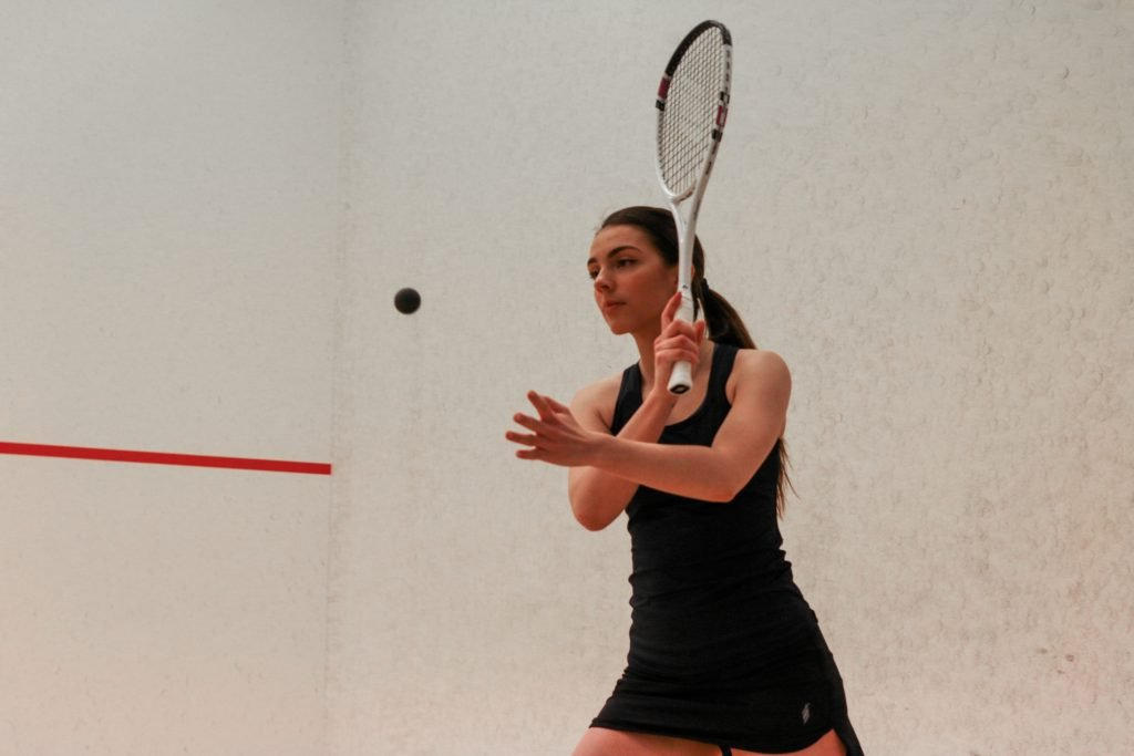 Chloe Kalvo hits the ball with squash racket,Norway