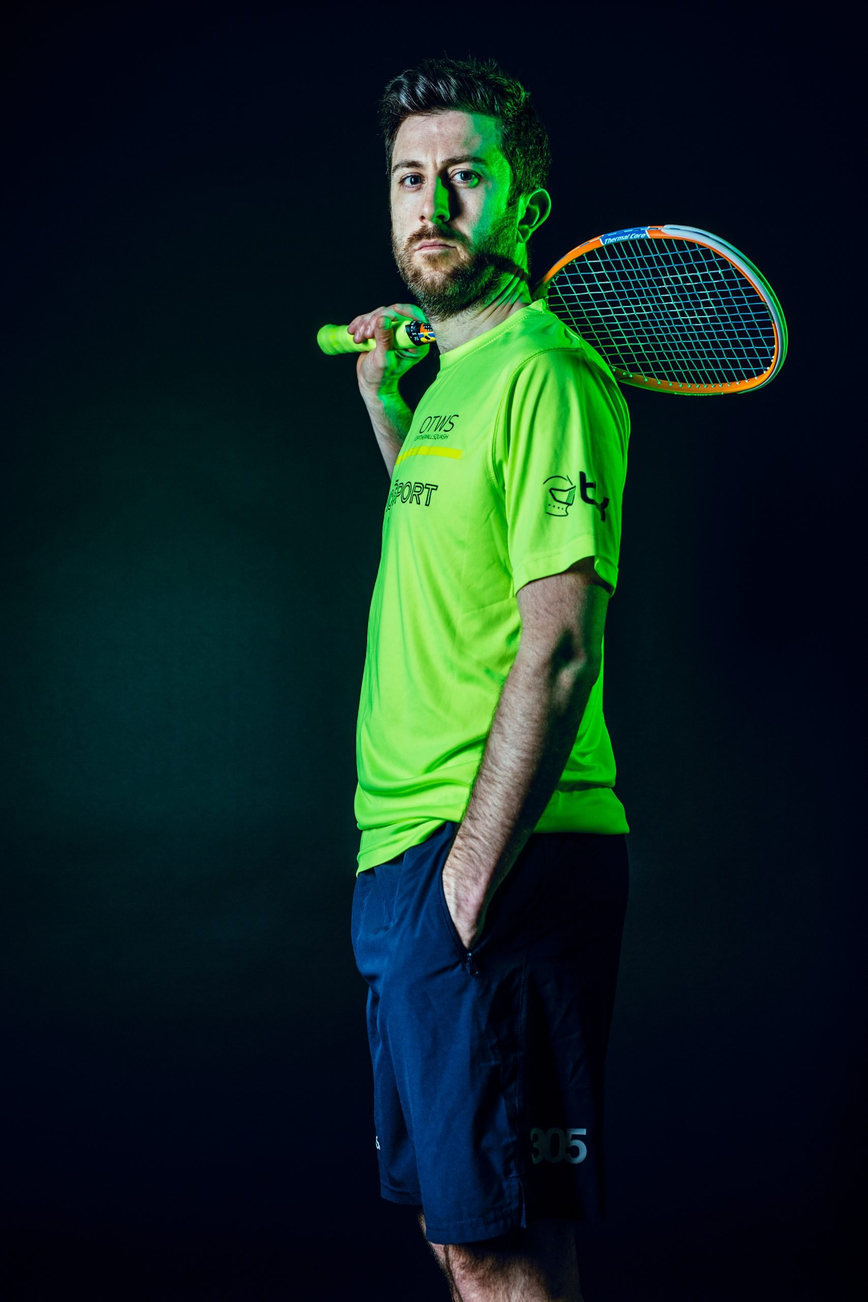 Daryl Selby, professional Squash player and owner Dynamic 7 Sport poses with a Squash racket.